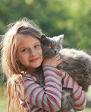 Happy child with cat. Kid showing Royalty Free Stock Photography
