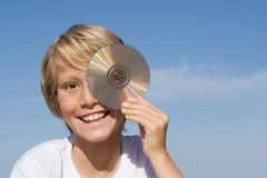 Happy child with cd or dvd Royalty Free Stock Photo