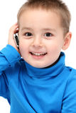 Happy child with cell phone Stock Images