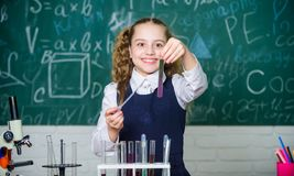Happy child. Chemistry lesson. student doing biology experiments with microscope. Chemistry education. Chemistry royalty free stock image