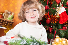 Happy child on the Christmas eve Stock Photos