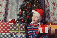 Happy child with christmas gift box. Christmastime Stock Photography