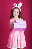 Happy child with christmas gift boxes Royalty Free Stock Photography