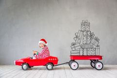 Christmas Xmas Winter Holiday Concept. Happy child with Christmas gift. Kid having fun at home. Xmas holiday concept royalty free stock images