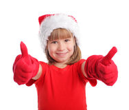 Happy child in christmas hat Stock Images