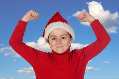 Happy child with Christmas hat celebrating something Royalty Free Stock Image