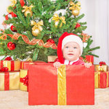 Happy child in christmas hat in gift box Stock Image