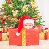Happy child in christmas hat in gift box Royalty Free Stock Photos