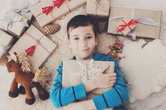 Happy child with Christmas present boxes and gifts, top view Stock Photos