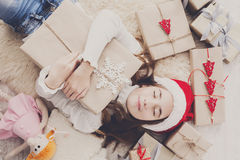 Happy child with Christmas present boxes and gifts, top view Stock Photo