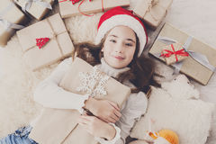 Happy child with Christmas present boxes and gifts, top view Royalty Free Stock Image