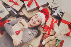 Happy child with Christmas present boxes and gifts, top view Royalty Free Stock Photos