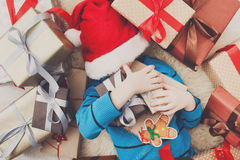 Happy child with Christmas present boxes and gifts, top view Royalty Free Stock Images