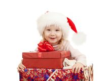 Happy child in Christmas Santa's hats with gifts Royalty Free Stock Photo
