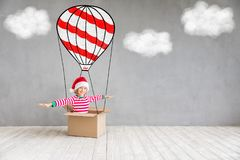 Christmas Xmas Winter Holiday Concept. Happy child in Christmas time. Funny kid playing at home. Xmas winter holiday concept Stock Photo