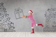 Christmas Xmas Winter Holiday Concept. Happy child in Christmas time. Funny kid playing at home. Xmas winter holiday concept Stock Image