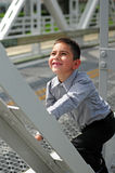 Happy child climbing Stock Photos