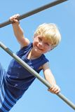 Happy Child Climbing at Playground Stock Image