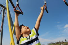 Happy child. Climbs from rope to rope Stock Photo