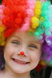 Happy Child in Clown Costume Stock Image