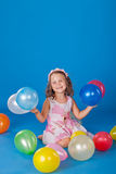 Happy child with colorful air ballons over blue stock photography