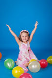 Happy child with colorful air ballons over blue Stock Image