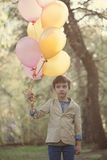 Happy child with colorful balloons in  celebration Stock Photos