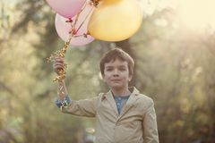 Happy child with colorful balloons in  celebration Stock Images