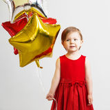 Happy child with colorful shiny foil balloons Royalty Free Stock Image