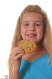 Happy child with cookie. Shot of a happy child with cookie Royalty Free Stock Images