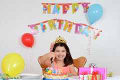 Happy child cutting birthday cake Stock Images