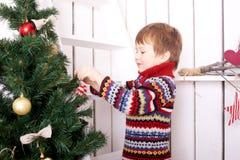 Happy child decorating the Christmas tree Royalty Free Stock Image