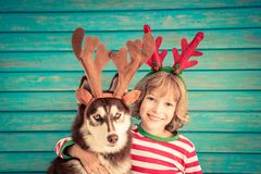 Happy child and dog on Christmas eve Stock Images
