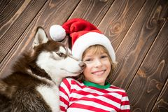 Happy child and dog on Christmas eve Royalty Free Stock Photography