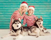 Happy child and dog on Christmas eve Stock Photos