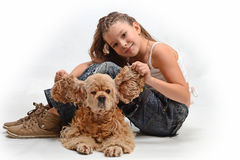 Happy child with a dog. Child lovingly embraces her pet dog Stock Photos