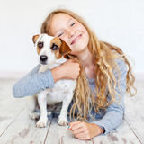 Happy child with dog. Portrait girl with pet Stock Photos