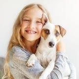 Happy child with dog Stock Photos