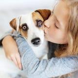 Happy child with dog stock image