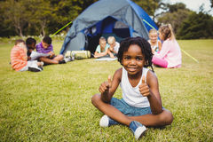 Happy child doing thumbs up during a sunny day Royalty Free Stock Photos