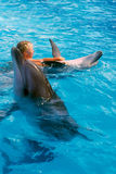 Happy child and dolphins in blue water. Dolphin Assisted Therapy. Child and dolphins in blue water. Dolphin Assisted Therapy royalty free stock image