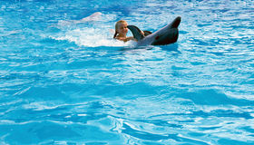 Happy child and dolphins in blue water. Dolphin Assisted Therapy. Child and dolphins in blue water. Dolphin Assisted Therapy royalty free stock photo