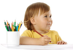 Happy child draw with crayon. Isolated over white stock photography