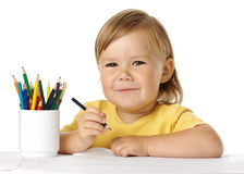 Happy child draw with crayons. Isolated over white Royalty Free Stock Photography
