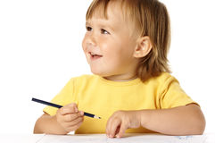Happy child draw with crayons and smile Stock Photos