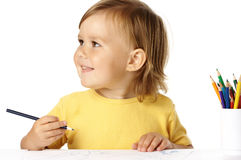 Happy child draw with crayons and smile Royalty Free Stock Image
