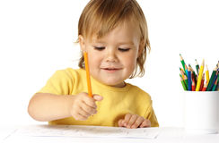 Happy child draw with crayons and smile Royalty Free Stock Photos