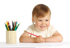 Happy child draw with red crayon Royalty Free Stock Images