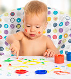 Happy child draws with colored paints hands Royalty Free Stock Photography