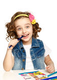 Happy child draws felt-tip pen. White background. Stock Photography